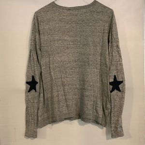 Sweater with star patch on elbow